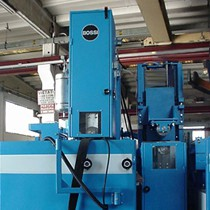 Grinding machines for the two opposite sides of strips